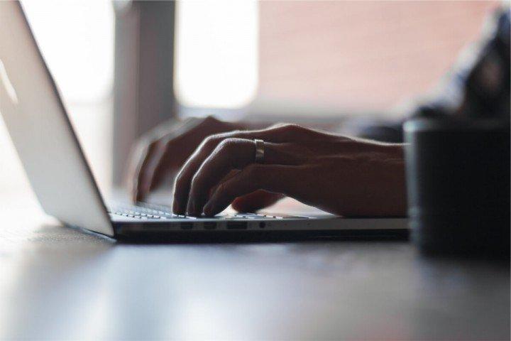 woman typing at laptop