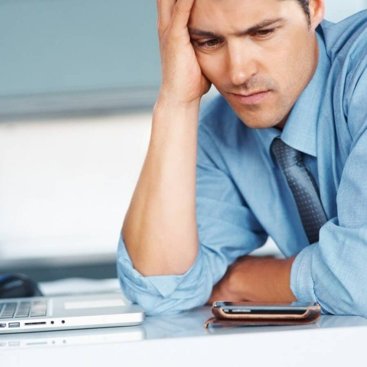 frustrated man with laptop and smart phone