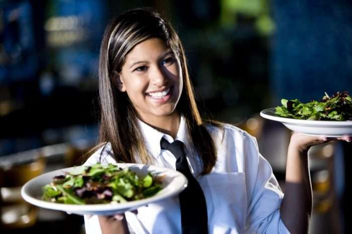 waitress with white shirt and black tie