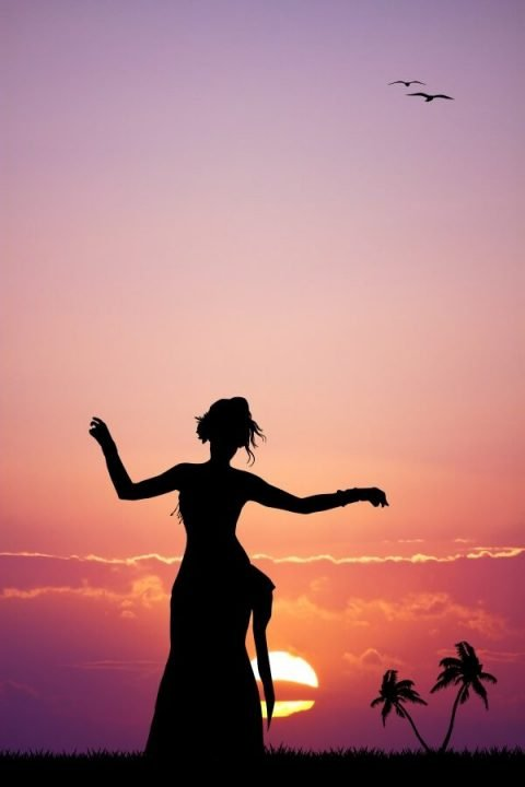 Silhouette of dancer at sunset