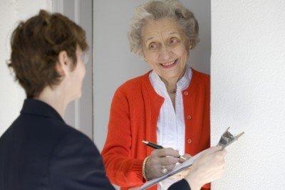door to door canvasser with older woman