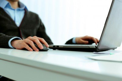 man at a desk working on a laptop