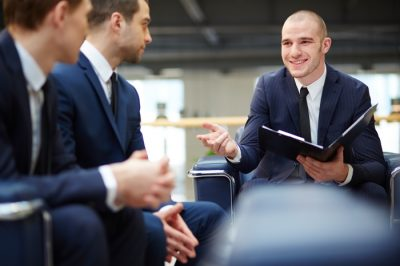 young men at a meeting or consulting