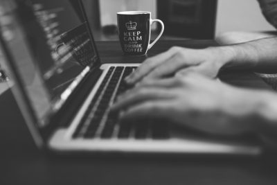 black-and-white-photo-of-laptop-and-coffee-mug