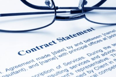 contract-statement-and-glasses
