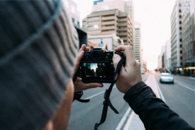 man with camera on city street