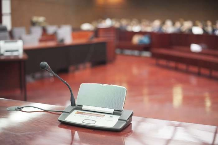 Judge orders compensation, reclassification for immigration court interpreters