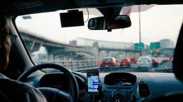 Optimized-dan-gold-176712-unsplash - man driving with gps phone