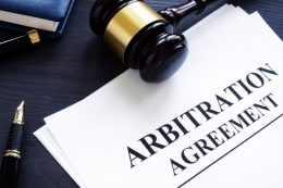 Arbitration agreement with gavel and blue background